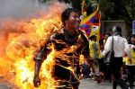 Tibetan+exile+Janphel+Yeshi+runs+as+he+is+engulfed+in+flames+after+he+set+himself+on+fire+during+a+protest+in+New+Delhi