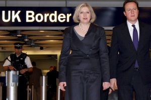 Cameron+and+Home+Secretary+Theresa+May+(L)+walk+through+Terminal+5+during+a+visit+to+UK+Border+Agency+staff