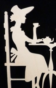 couple_sharing_tea_time_victorian_style_wood_display_silhoue_8b1071a31