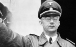 """Heinrich Himmler...FILE - The undated file photo shows German Nazi party official and head of the SS, Heinrich Himmler. at unknown location in Germany. German newspaper Welt am Sonntag has published a trove of letters believed to be written by Nazi SS leader Heinrich Himmler. On seven full pages the paper on Sunday Jan. 26,2014 showed pictures of Himmler and his family smiling into the camera during a fishing trip, the top Nazi taking a bath in a lake or feeding a little fawn. The newspaper, which says the material is contained in an eight-part series it plans to publish, also quotes excerpts from Himmler's love letters addressing his wife as """"my sweet, beloved little woman."""" Welt said it worked together with Israeli film director Vanessa Lapa, whose family had the documents in its possession. (AP Photo/str/file)"""