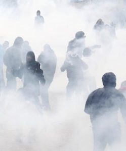 """Tear gas fills the air as French riot police face off with demonstrators near the area called the """"jungle"""" where migrants live in Calais, France, October 1, 2016. REUTERS/Pascal Rossignol"""
